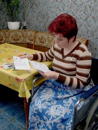 The woman-invalid look accounts       photo