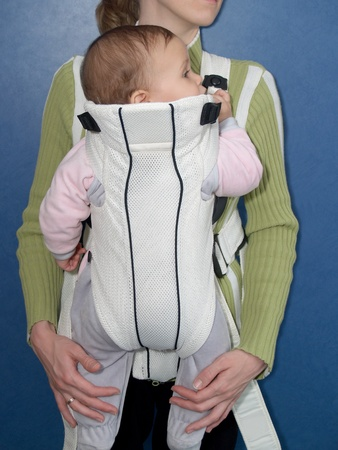 2 5 months: Mother keeps the child in a baby sling