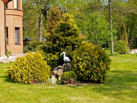 Landscaping with a heron figure photo