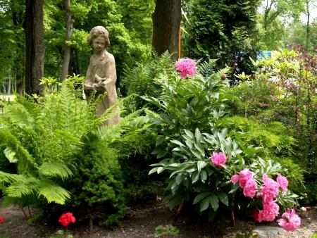 Sculpture of the girl in park Stock fotó