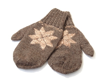 Knitted mittens on a white background photo