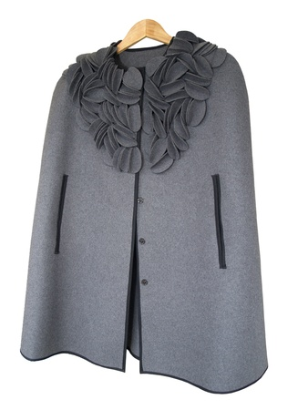 Ladies  coat cape on a white background photo