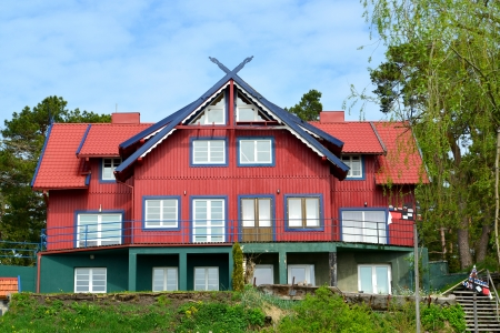 The red wooden house in Nida, Lithuania Stock Photo