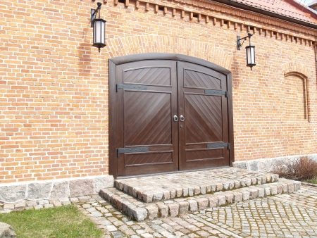 Brick facade with wooden gate photo