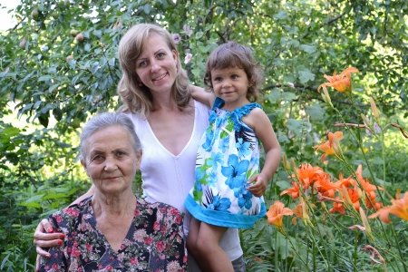 75 80: Family portrait in a garden, three generations
