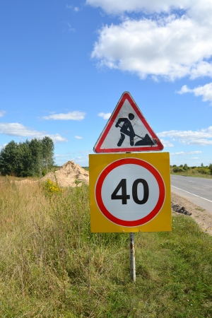 inhibitory: Road signs  Roadwork  and  Restriction of maximum speed of 40 km