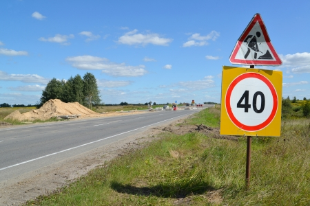 inhibitory: Road signs  Roadwork  and  Restriction of maximum speed of 40 km  on a road roadside Stock Photo