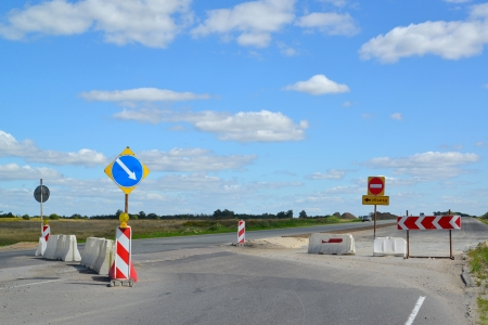 inhibitory: Group of road signs, barriers and road detour