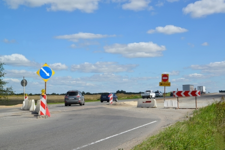 inhibitory: Cars make a detour on a highway