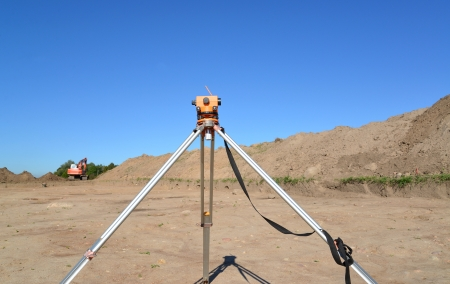 Level against earthwork in archaeological expedition photo