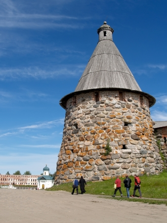loopholes: Pilgrims go by a tower of the Solovki monastery