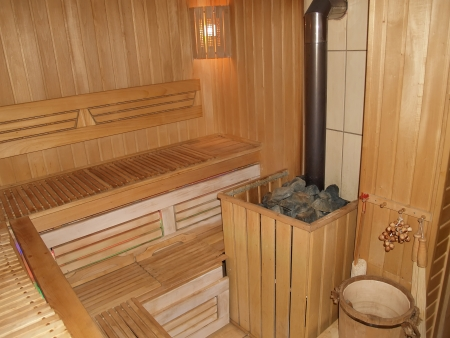 Sauna interior with the furnace  Stock Photo