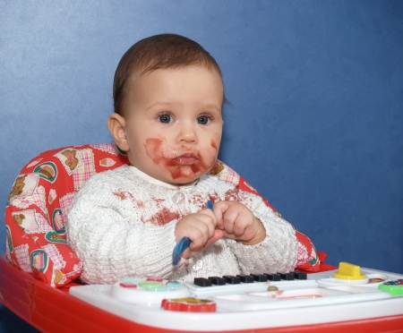bedaubed: The little girl bedaubed with food