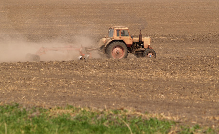 Spring processing weeding a tractor Stock Photo - 25705450