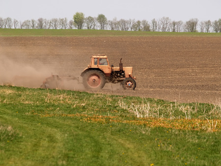 Spring processing weeding a tractor photo