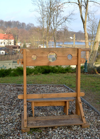 derision: Pillory in the lock Ryn, Poland Stock Photo