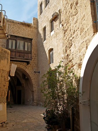 Small street in ancient Yaffo, Israel photo