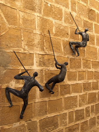 papiermache: Figures of the people clambering on a wall. Yaffo, Israel Editorial