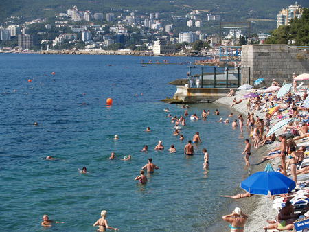 Crimea. People have a rest on a beach in Yalta