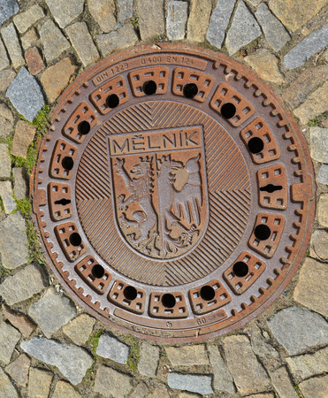 Hatch cover in the city Melnik, the Czech Republic photo