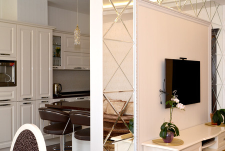 The interroom wall partition issued by mirrors between a drawing room and kitchen photo