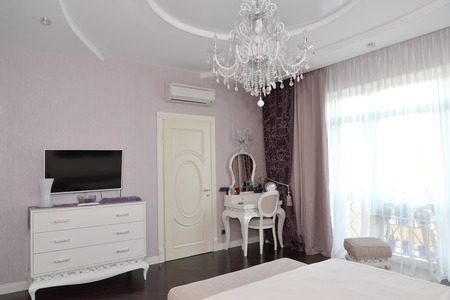 a toilet stool: Bedroom interior with white furniture. Modern classics with rococo elements
