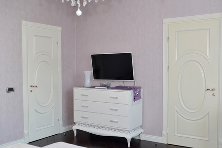 White dresser in a bedroom. Modern classics with rococo elements photo