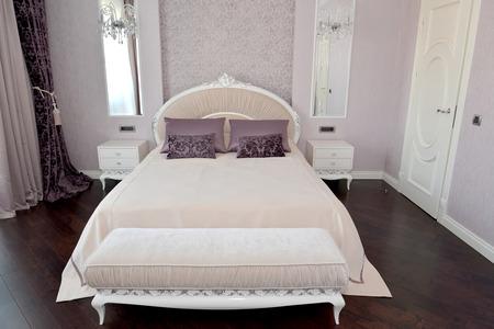 classics: Bedroom interior in light tones. Modern classics with rococo elements