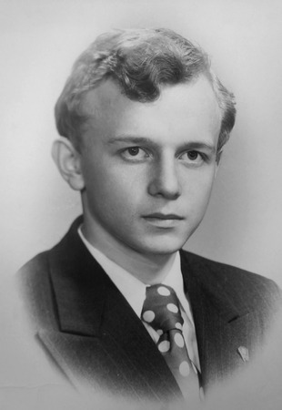 The young man s portrait with a Komsomol badge on a lapel, 1976 (without retouch)