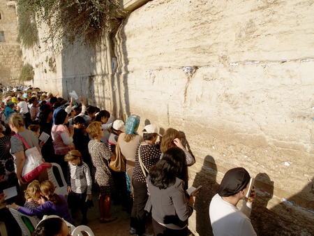 The crowd of pilgrims prays at the Wailing Wall in Jerusalem, Israel