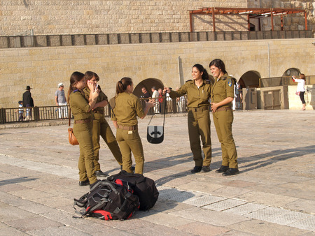 Female military personnel of the Israeli army on the square in front of the Wailing Wall. Jerusalem, Israel Editorial
