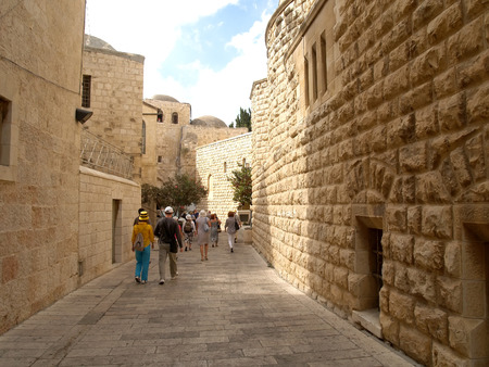 The group of tourists goes on the old city on the Mount Zion. Israel, Jerusalem