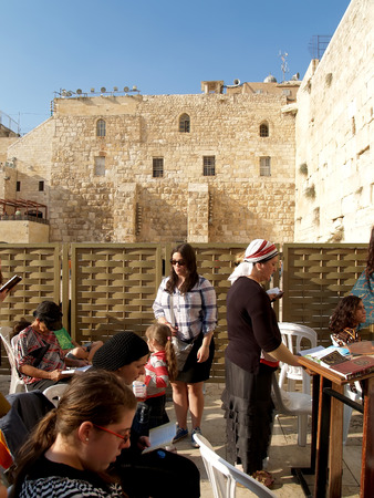 The believing women read religious books before the Wailing Wall in Jerusalem, Israel