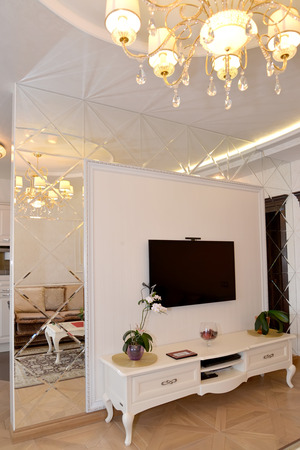 mirror on the wall: Interroom mirror wall partition in a living room. Modern classics with rococo elements