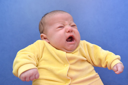 Portrait of the crying baby on a blue background Stock fotó - 34366481