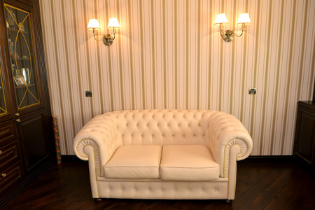 Fragment of an interior of a house office with a white sofa photo