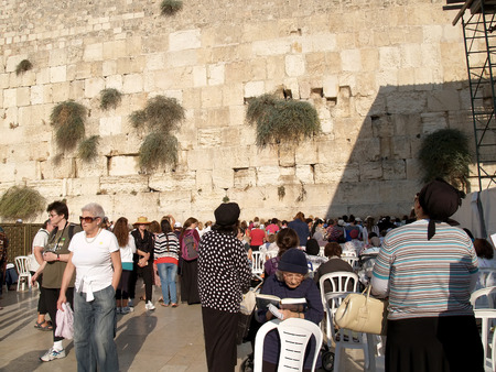 Pilgrims on a female half at the Wailing Wall in Jerusalem, Israel