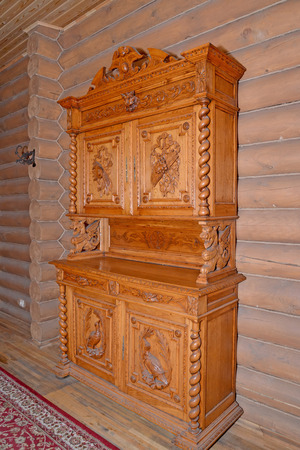 dresser: The old wooden dresser stands near a timbered wall in a sauna Stock Photo