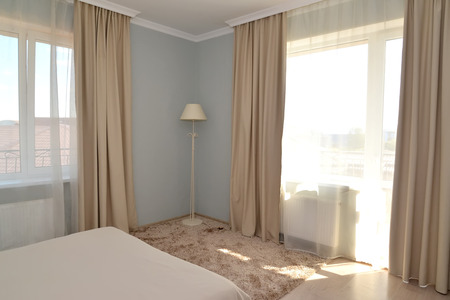 inhabited: Fragment of an interior of a hotel room in light tones with two windows Stock Photo