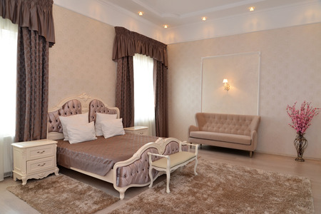 classics: Interior of a bedroom of a double hotel room luxury in brown tones. Modern classics
