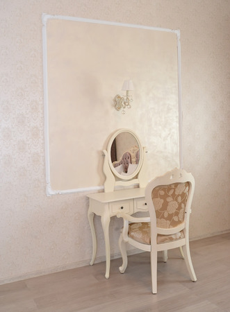 wall sconce: Dressing table and white chair in a hotel room luxury Stock Photo