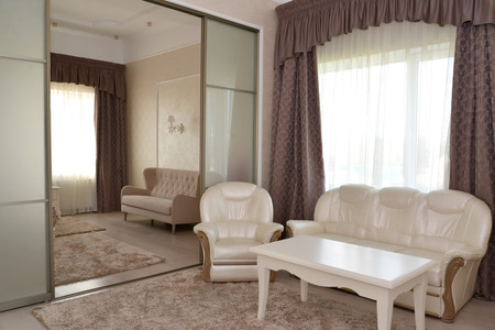 glass partition: Fragment of an interior of a bedroom and drawing room of a double hotel room luxury with a glass interroom partition. Modern classics Stock Photo