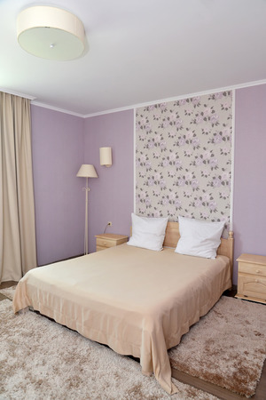sconce: Interior of a bedroom of a double hotel room in light tones. Bedroom Stock Photo