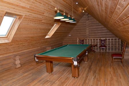 billiards halls: The billiard hall on a mansard floor of the guest house Stock Photo