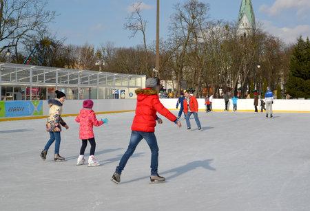 skating rink: People ride a skating rink. Central park of rest, Kaliningrad Editorial