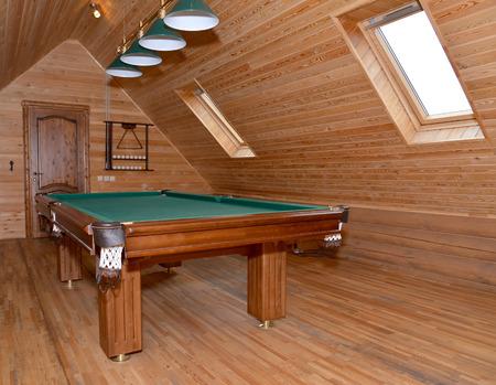 billiards rooms: The billiard hall on a mansard floor of the guest house Stock Photo