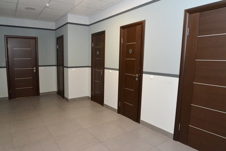 Interior of a corridor of office building with doors