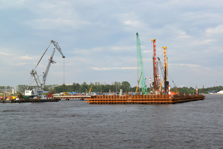 poppet: ST. PETERSBURG, RUSSIA - JULY 09, 2014: Construction of the mooring on the Neva River