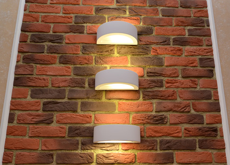 sconce: The decorative wall panel as brick with illumination of a sconce in an interior Stock Photo