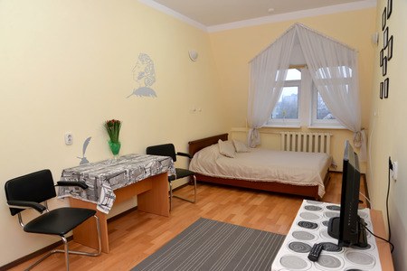 unpretentious: Single hotel room with a portrait of the Russian poet A.S. Pushkin to a wall
